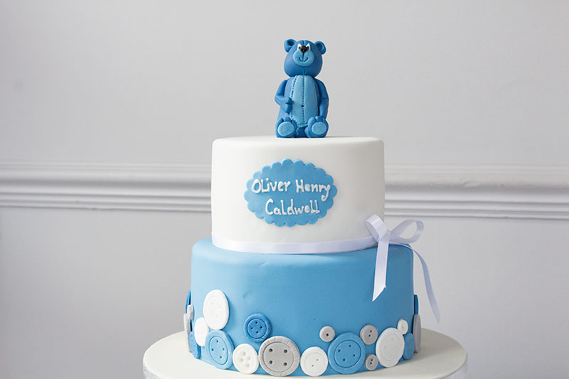 Two-Tier-Baby-Shower-Cake-with-Teddy-Bear-and-Buttons.jpg