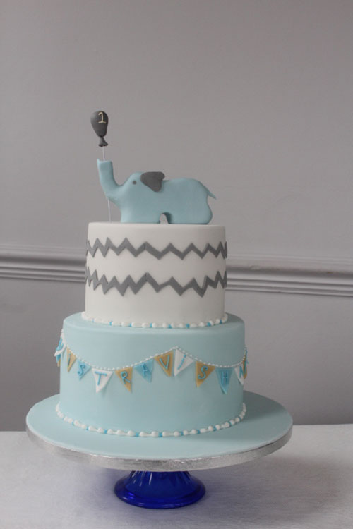 Two-Tier-Christening-Cake-with-Elephant-Topper-and-bunting.jpg