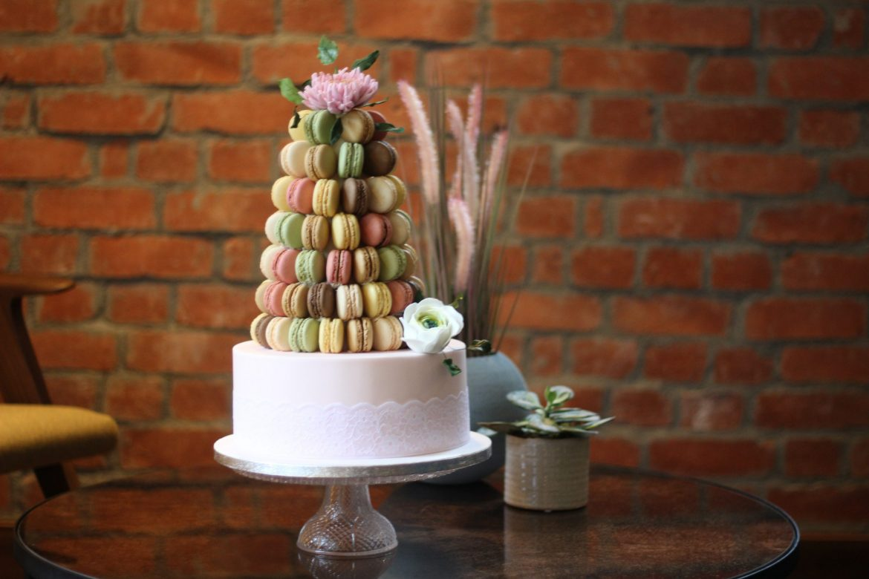 Macaron-tower-Wedding-Cake-With-Edible-Sugar-Flowers-scaled.jpg